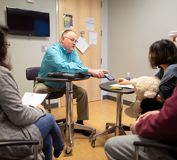 Counselor talking to family in clinic