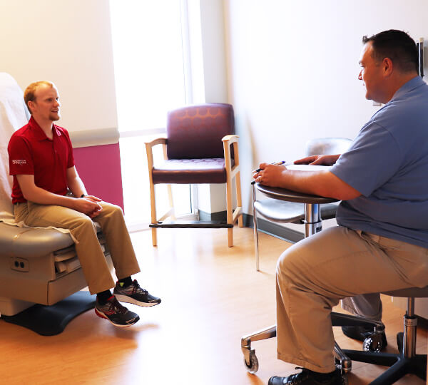Social worker talking to male patient